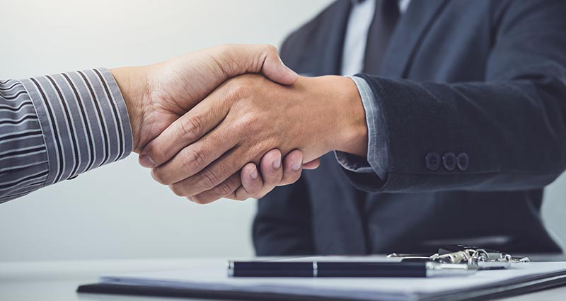 Salesman shaking hands with customer