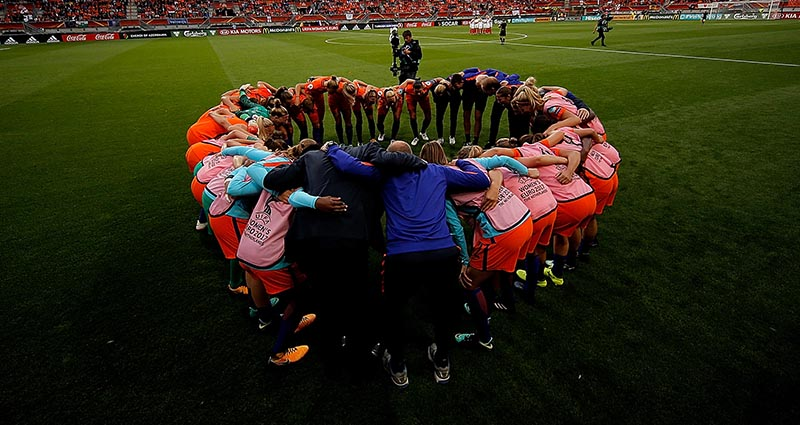 Women's Football Group Hug