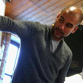 Pep Guardiola discussing his team's plan